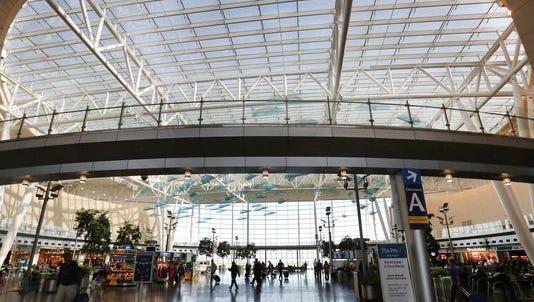 Passengers walk through the main terminal at Indianapolis International Airport.