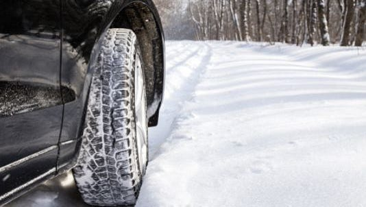 Motorists should expect a slick morning commute after 10 or more inches of snow fell on parts of the Lansing region Tuesday, the National Weather Service reported