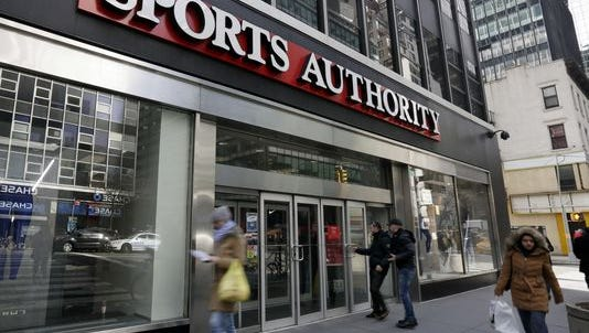 People enter a Sports Authority store, in New York, Wednesday, March 2, 2016. Sports Authority is filing for Chapter 11 bankruptcy protection.