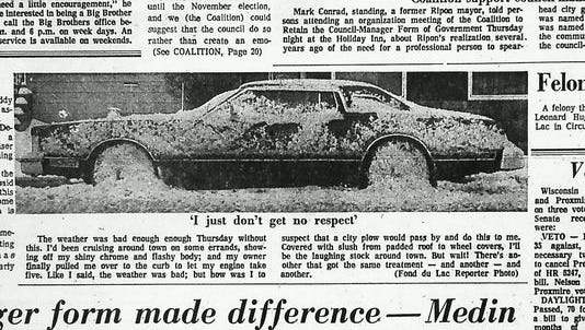 The Fond du Lac Reporter ran a picture of a car frozen in ice on March 5, 1976.