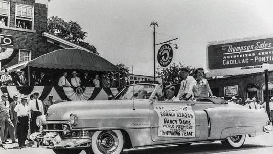 """Ronald and Nancy Reagan ride in a parade held in Springfield in 1952 in conjunction with President Harry Truman's visit and the premiere of the film """"The Winning Team."""""""