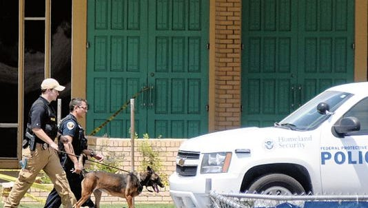 The Department of Homeland Security investigates the area near First Presbyterian Church in Las Cruces on Friday, Aug. 14, 2015, after the Doña Ana County Sheriff's bomb squad disabled a suspicious device near the church.