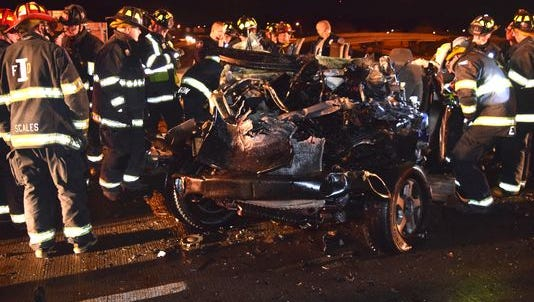 Medics and firefighters responded to a crash Dec. 23, 2015, on South East Street that killed three people.