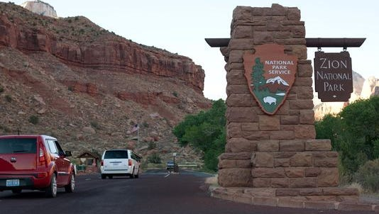 Drivers approach the entrance station to Zion National Park.