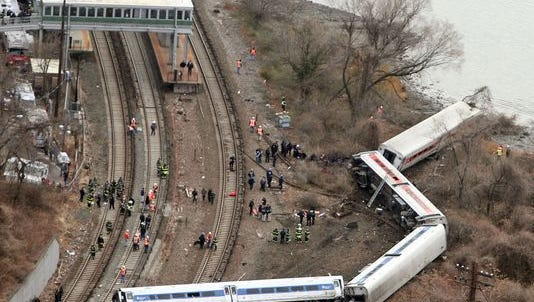 Emergency personnel at the scene of a Metro-North train that derailed just north of the Spuyten Duyvil station in the Bronx on Dec. 1, 2013.