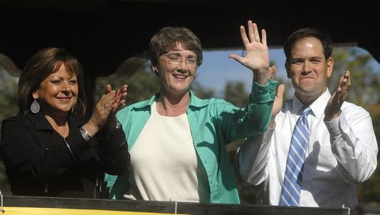 New Mexico Senate candidate Heather Wilson waves to a crowd of locals with New Mexico Gov. Susana Martinez and Flordia U.S. Sen. Marco Rubio Wednesday, Oct. 25, 2012. Martinez and Rubio were campaigning for Wilson. Martinez recently announced she is supporting Rubio in his presidential campaign.