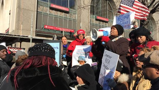 A parent addresses a crowd of schools protesters in January in Detroit.