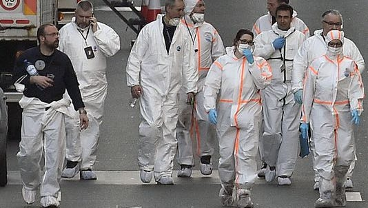 Forensic staff leave the metro station Maelbeek in Brussels, Tuesday, March 22, 2016.