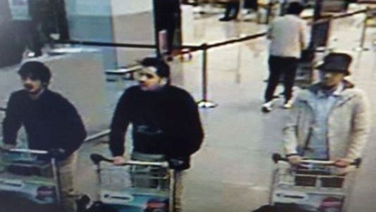 A picture released by the Belgian Federal Police shows a screen grab of the airport CCTV camera showing suspects of Tuesday's attacks at Brussels Airport.