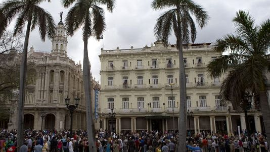 People lined the street outside Havana's Grand Theater, left, in March hoping to see U.S. President Barack Obama.