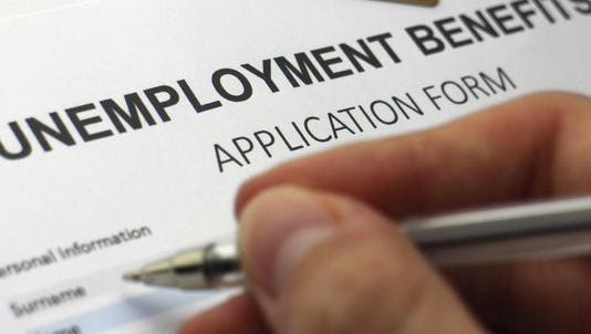 A file photo of a person filling out an unemployment form.
