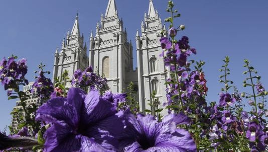 In this Sept. 3, 2014, file photo, shows flowers blooming in front of the Salt Lake Temple in Temple Square in Salt Lake City.