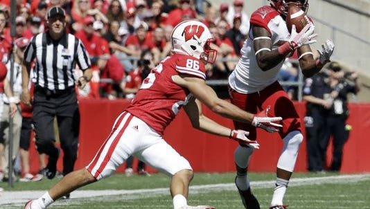 Miami of Ohio's Marshall Taylor, right, intercepts a pass in front of Wisconsin's Alex Erickson (86) during the first half of an NCAA college football game Saturday, Sept. 12, 2015, in Madison, Wis.