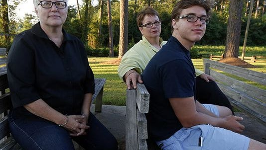Hudson Garner, 15, with his mothers Kathryn Garner and Susan Hrostowski, left, in 2015. Garner and Hrostowski are one of the four lesbian couples who sued the state in federal court over its same sex adoption ban.