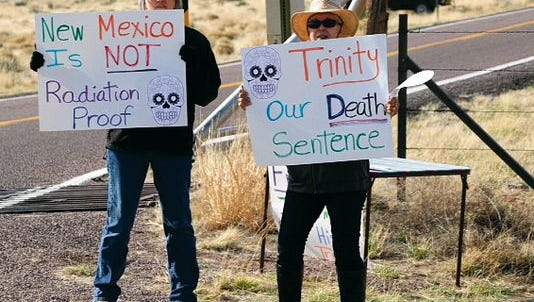 In this file photo, Tularosa Downwinders protest outside the Trinity Site to raise awareness on New Mexican's health issues due to the Trinity atomic bomb test.