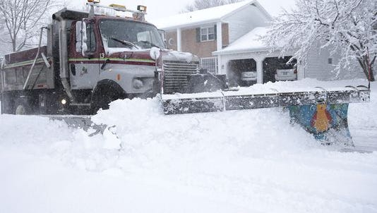 A snow plow clears a street while a snowstorm rolled through Appleton on Feb. 2.
