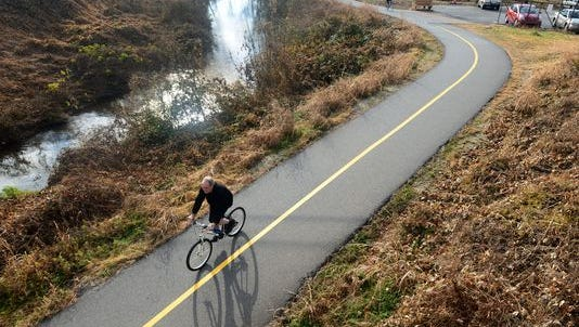 Officials hope to one day see a walking and biking trail like the Swamp Rabbit Trail, above, from Greer to Greenville.