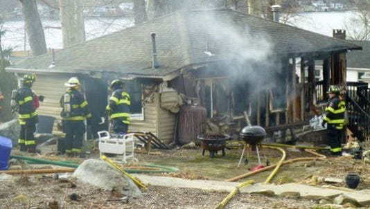 Firefighters at a bungalow fire on March 3, 2016 in the Nolan's Point section of Jefferson Township.