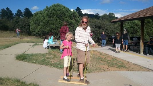 Girl Scouts of the Desert Southwest enjoyed their annual Family Day Picnic at Little Walnut Picnic Grounds on Oct 4. Father and daughter team Keith and Lila Knadler of troop 321, compete in the Buddy Walkers competition.