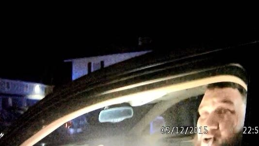 Derek J. Twyman sits in his car before his May 12 arrest in this screenshot from a Gettysburg Borough police officer's body camera.
