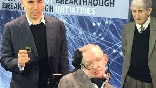 Yuri Milner and Stephen Hawking with the new Starshot chip.