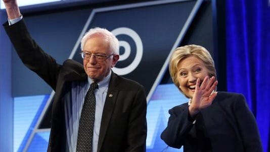 Democratic presidential candidates Hillary Clinton and Sen. Bernie Sanders, I-Vt., stand together before the start of a presidential debate in Miami on March 9.