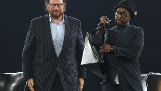 """Salesforce CEO Marc Benioff (left) is shown at ExactTarget Connections event in 2014. At right is musician and philanthropist will.i.am. Benioff's tweets soon after Indiana's """"religious freedom"""" law was signed on March 26 helped to quickly galvanize opposition from outside the state against the law."""