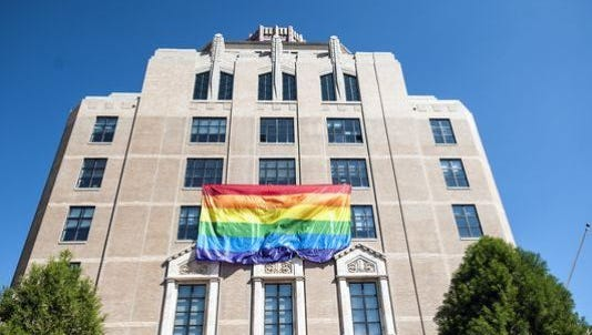 Asheville city officials flew an LGBT banner from City Hall in October 2014 in support of a federal same-sex marriage decision.