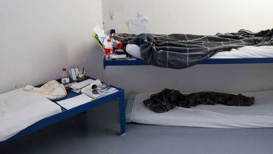A mattress used by an inmate is placed on the floor beneath one of the bunks in a cell at the Rutherford County Adult Detention Center. Three inmates use the cell meant for two.
