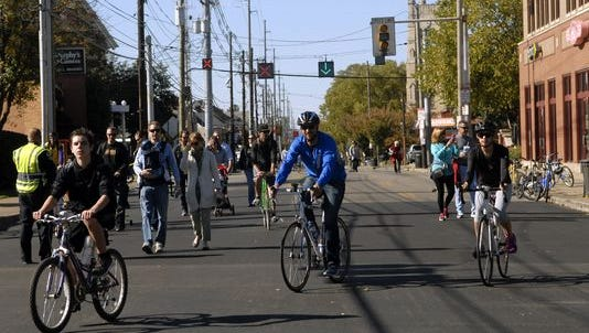 Hundreds of people flock to the street to ride their bikes, walk and skate during the 4th annual CycLOUvia on Bardstown Rd. Sunday afternoon.