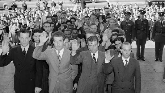 Men complete the induction process, at Los Angeles City Hall, on Nov. 18, 1940, after being chosen to serve in the military under Selective Service Act.