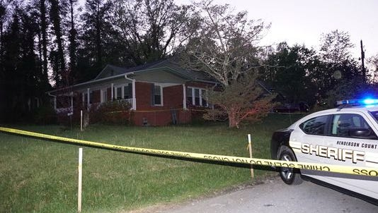 Officials are investigating a police-involved shooting after an East Flat Rock woman drew what appeared to be a weapon during a confrontation in her home.