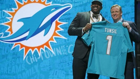 Laremy Tunsil tumbled down the NFL draft board Thursday night after a bizarre video of him was posted on his Twitter account minutes before the start of the proceedings, potentially costing the offensive lineman millions of dollars.