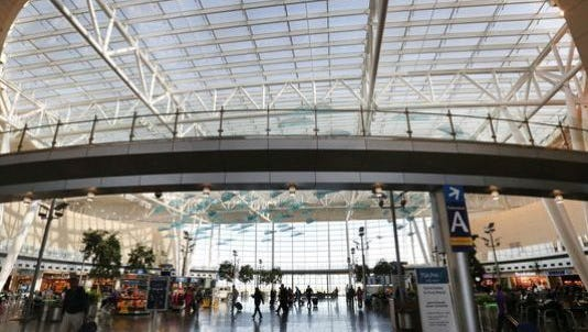 Passengers walk through the Indianapolis International Airport terminal.