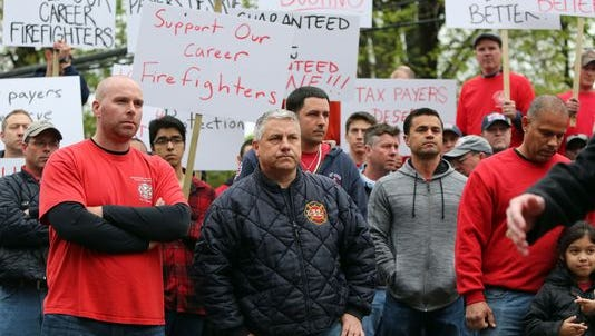 Port Chester career firefighters and supporters protest Tuesday at Village Hall.