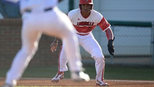 Corey Ray leads off first base during the UofL baseball game against University of Kentucky at Cliff Hagan Stadium in Lexington, Ky., on Wednesday, April 13, 2016.