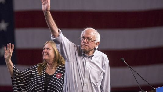 In this file photo, Democratic presidential candidate Sen. Bernie Sanders, I-Vt., with his wife Jane, waves at a rally Aug. 10, 2015, at the Los Angeles Memorial Sports Arena in Los Angeles.