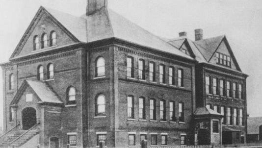 Historic photo of the Church Street School. The 3rd Floor with the gabled roof burned in a fire and was never replaced.