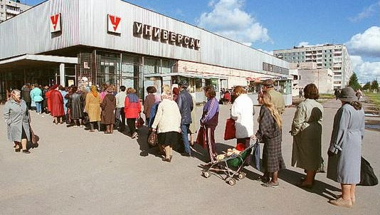People line up at a Universet food store in Leningrad, USSR, in 1991.