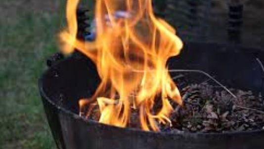 Fire pits must be at least 25 feet from a structure in Buncombe County for safety reasons.