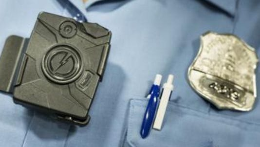 A proposal to require policies for body cameras won't see action until at least November.