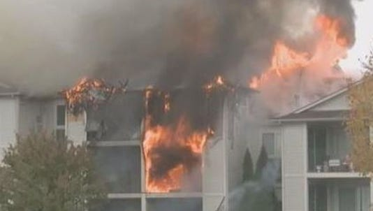 Firefighters battle a blaze at the ClearView Apartments in Holland, Mich., Oct. 10, 2012.