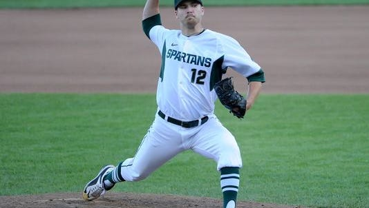 Spartans pitcher Jake Lowery pitches in relief during Friday's loss to Ohio State in the Big Ten Baseball Tournament at TD Ameritrade Park.