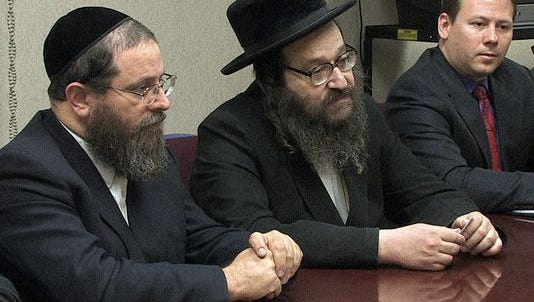From left, developer Michael Tauber, Rabbi Mordecai Babad and attorney Roman Storzer discuss Tartikov's plans for a rabbinical college in Pomona