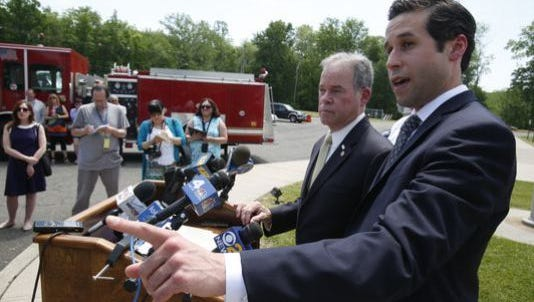 Assemblyman Kenneth Zebrowski, D-New City, and Republican County Executive Ed Day, announce plans for inspectors of schools chosen by the state