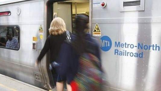Riders board a Metro-North train.