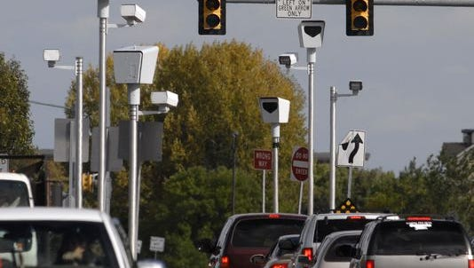 Red light camera stands on the east and west ends of the intersection of Harmony Road and Timberline Road on Oct. 11, 2011.