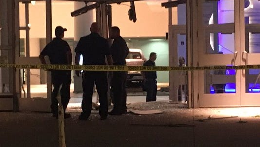Police suspect alcohol and/or drugs were a factor after a driver plowed a truck through the front doors of the Colorado Convention Center Monday night, leaving two bystanders with minor injuries.