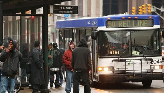 The IndyGo bus stop at Ohio and Pennsylvania streets in Downtown Indianapolis is packed with riders on Jan. 29, 2015.