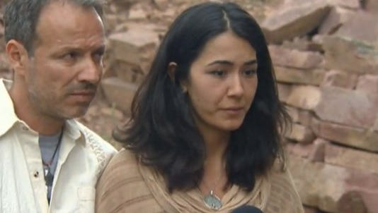 Sitora Yusufiy spoke to the media outside of a home in Boulder Sunday afternoon.